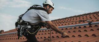 Tile roof fall protection rail system